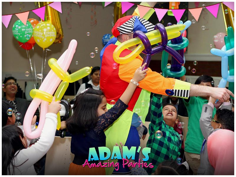 Adam with balloons, kids chasing and bubbles